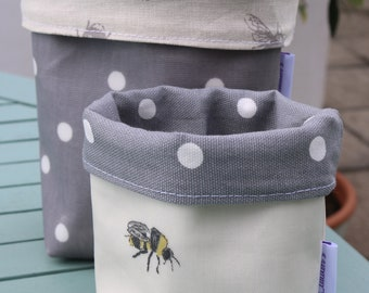 Cotton and oilcloth fabric buckets. Storage pots.
