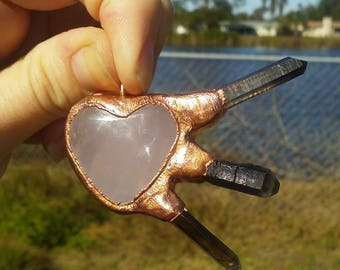 Copper rose quartz heart pendant necklace with smoky quartz crystals.