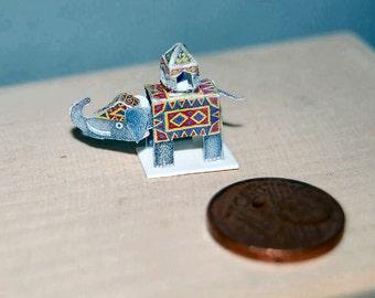 Elephant with bobble head, miniature
