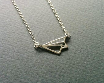 Origami paper plane. Necklace.