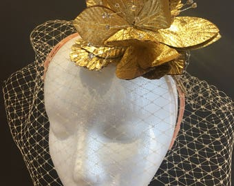 Bridal headpiece with birdcage veil and gold flower