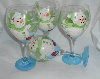 Hand painted skating snoewmen. set of 4  goblets. made in the usa.blue , white red green