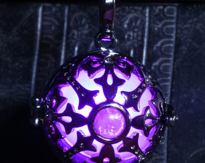 Glowing necklace pendant, locket with white glowing LED orb and purple opal stone