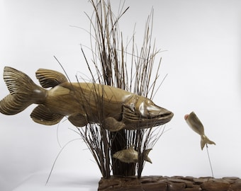 The Predator Becomes The Prey. Hand Carved walnut Northern Pike Wood Sculpture