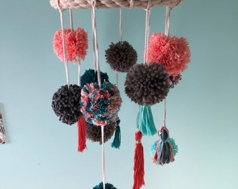 Pom pom mobile featuring teal, coral, gray and aqua