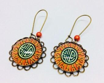 Cabochon dangle earrings orange Japan