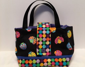 "LBL7- Tall Lunch Bag- Large: ""Dot Dot Dot Dashing""  washable insulated lunch bag with drawstring closure at the top."