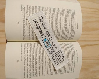 Save Your Progress Bookmark (Handmade/Hand-stitched)  - Fabric bookmark with save symbol.