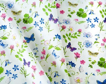Organic cotton fabric printed with spring flowers, butterflies in pink, blue, ultra violet, green. Organic Cotton by 1/2 meter or 1/2 yard.