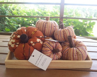 Decorative Fabric Pumpkins: felt stems on fall stripes and autumn branches