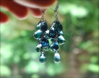 London blue topaz earrings. Solid gold blue topaz briolette cluster earrings. Gemstone cascade earrings in navy blue. Faceted teardrops.