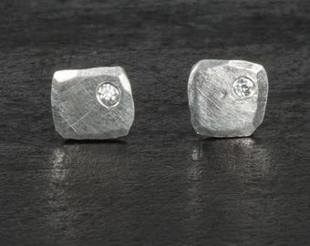 Square stud earrings, shiny, matte, sterling silver with cubic zirconia.