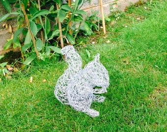 Squirrel wire sculpture. Garden. Garden decor. Garden ornament. Metal garden Sculpture. Wire sculpture. Outdoor. Patio. Wildlife. Animal.