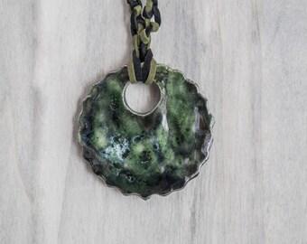 Round pendant flower shape ceramic glazed green reflections black
