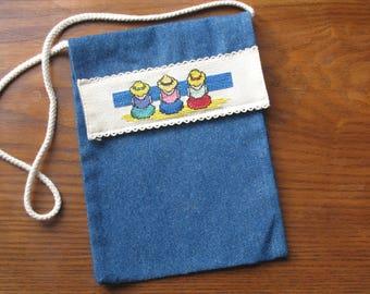Navy embroidered denim shoulder strap bag