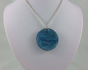 Necklace: round blue resin pendant on silver chain; gift for her