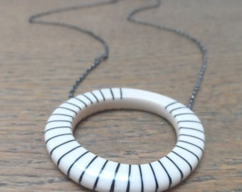 Big hoop necklace with black stripes