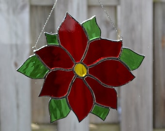 Poinsettia Stained glass suncatcher hanging from silver steel chain