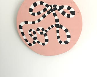 Abstract black & white stripe painted pattern on plywood circle