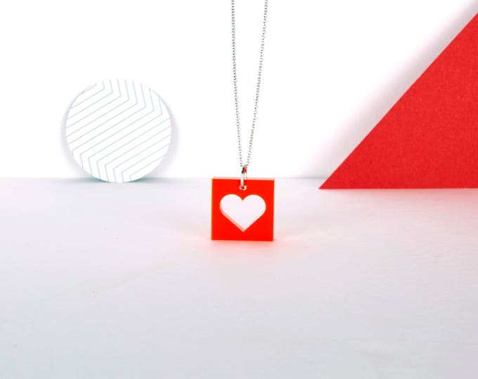 Mini red HEART graphic acrylic necklace in transparent neon red