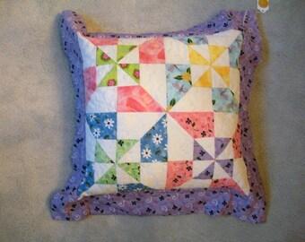 Colorful pinwheel pillow
