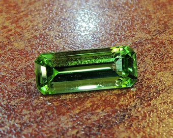 Peridot from Burma, large Emerald cut peridot, 3 32cts 5.8 x 14.2 mm