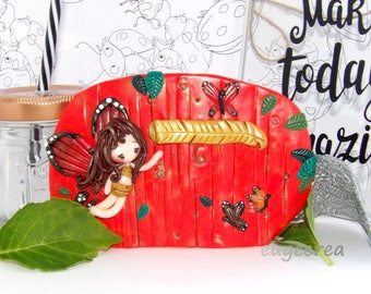 Doll with polymer clay Butterfly door plaque
