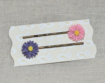 Hair clips in hair with pink and purple daisies in retro style flower cabochons