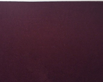 Burgundy textured knit fabric