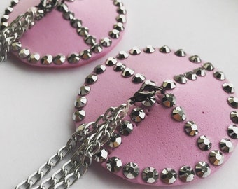 Pink pasties with silver rhinestones and a detachable chain tassel