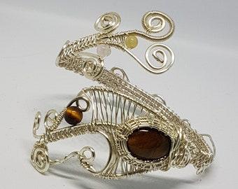 handmade jewelry , silver plated copper wire , tiger eye bracelet .32