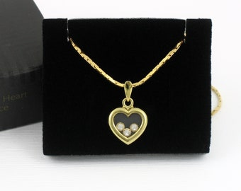 1994 Vintage AVON 'Jewelesque Heart Necklace' /Original Box. Floating Crystal Necklace. 19 inches long. Vintage Avon Jewelry. Heart Necklace