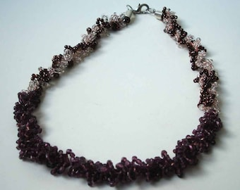 Crocheted necklace with seed beads in brown and white