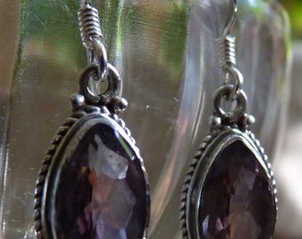 Sterling silver earrings with faceted amethyst