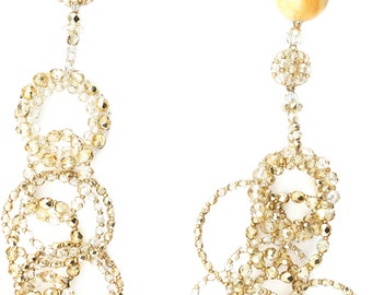 Long necklace with golden glossy crystal rings and two medium Siena yellow marble spheres