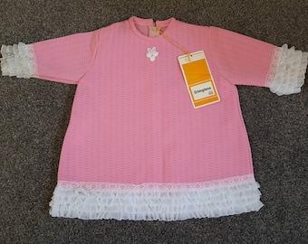 1960s vintage crimplene pink girls dress with frills