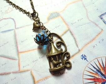 Bronze, bronze tone charm necklace birdcage bird crystal glass bead turquoise heart
