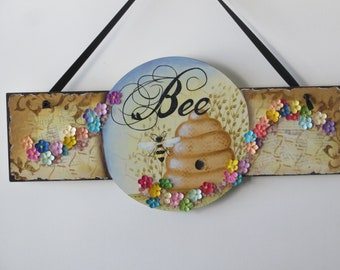 Hand painted circle sign board with bee hive, bee, flowers and mica flakes