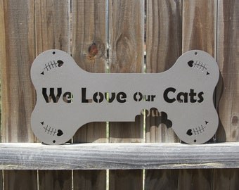 We Love Our Cats Outdoor Metal Wall Sign with Fish Skeletons