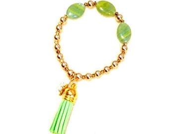 Stretchy bracelet, gold round beads, oval glass beads, lime green, tassel, inspirational, civility, see beauty, hear goodness, speak kindly
