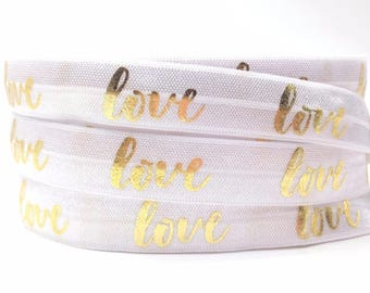 1 m of beautiful white elastic band printed LOVE effect (metallic gold)