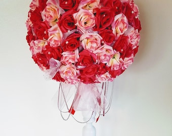 Pink and red rose flower ball faux pomander with pearls and pink crystal ribbon on white stand, wedding floral center piece supply