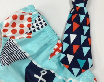 Aqua, navy diaper cover & tie set.