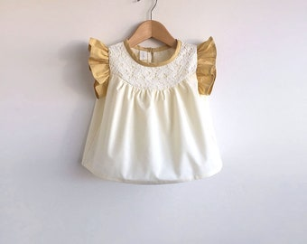 girls pale yellow blouse with lace detail