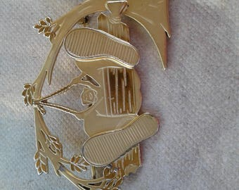 Goldtone Brooch/Girl With Big Feet Swinging On Tree Bench