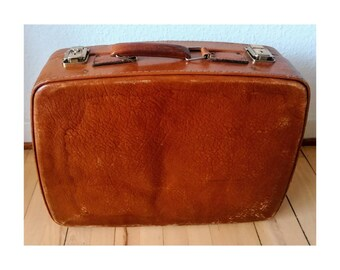 Vintage leather suitcase with key