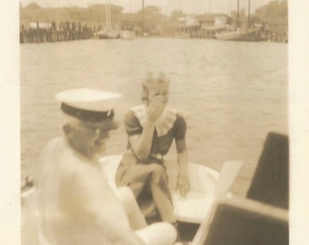 """Vintage Snapshot """"Shirtless Captain"""" Pretty Girl Covers Her Eyes Captain's Hat Boating Found Vernacular Photo"""
