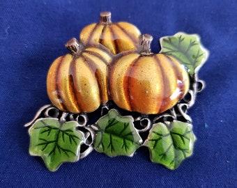 Enamel and steel pumpkins pin.