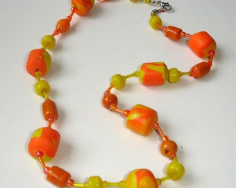 Polymer clay necklace in orange and yellow