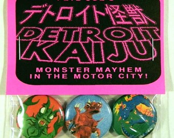 "Pete Coe's Detroit Kaiju 1"" Pinback Button Set of 3 Monsters:Space Evil (Vihreku), Ancient Dinosaur (Torgorro), Electric Monster (Gustralek)"
